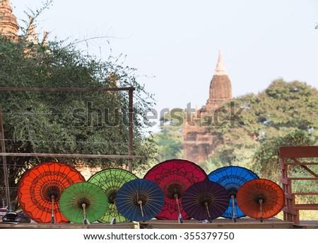 Colorful umbrellas  in Bagan, Myanmar. - stock photo