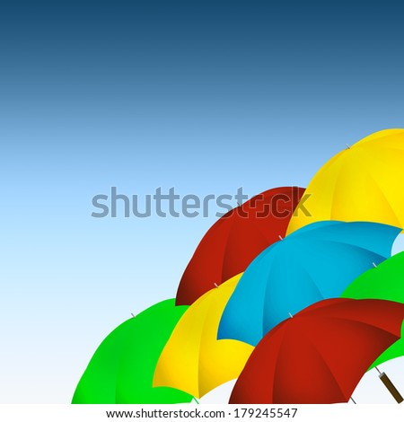 Colorful umbrellas on blue gradient background.