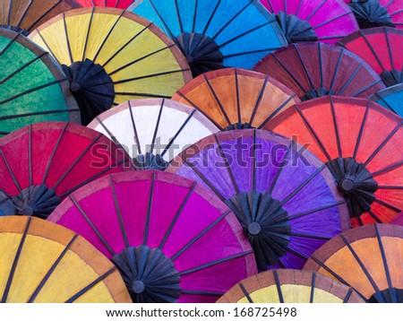 Colorful umbrellas on display at street market in Luang Prabang, Laos.  - stock photo