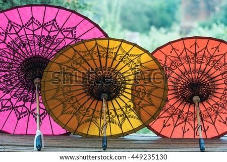 Colorful umbrellas on street market in Bagan, Myanmar (Burma). - stock photo