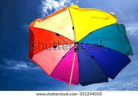 Colorful umbrellas on the beach,beautiful  umbrellas with blue sky - stock photo