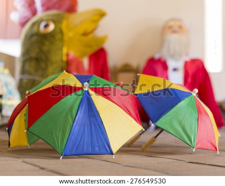 Colorful umbrellas sitting on the ceramic floor of a historic construction in Olinda, PE, Brazil. Little colorful umbrellas are the symbol of Recife and Olindaâ??s carnival festival. - stock photo