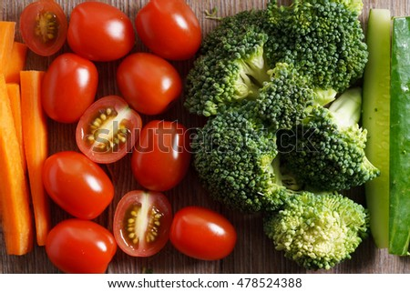 colorful vegetable, red and green, on wooden background