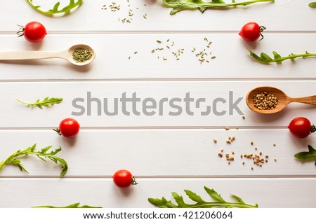 Colorful vegetables ingredients for healthy cooking. Composing on white wooden background. Vegan nutrition and diet food concept. Top view - stock photo