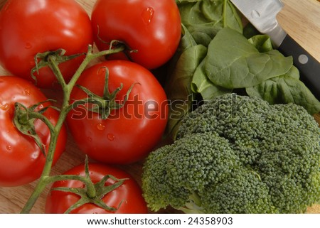 Colorful Vegetables on Cutting Board - stock photo