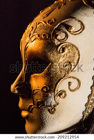 Colorful Venetian carnival mask, close-up. - stock photo