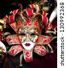 Colorful Venetian carnival masks for sale. - stock photo