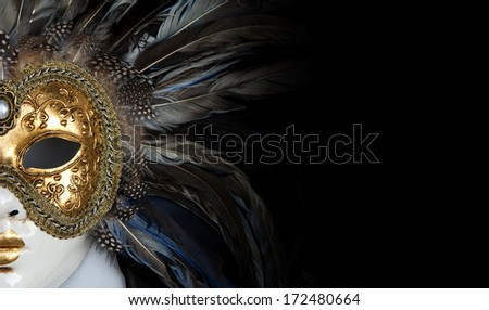 Colorful venetian mask with many details on it - stock photo