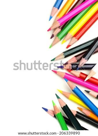 Colorful vertical pencil crayon border over white - stock photo
