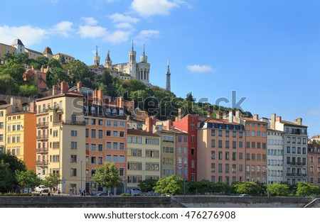 Colorful Vieux Lyon and Fourviere Basilica seen from the Saone riverbank.