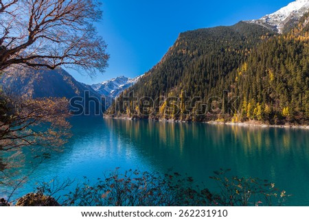 Colorful view of lake and forest in Jiuzhaigou national park, Sichuan Province, China - stock photo