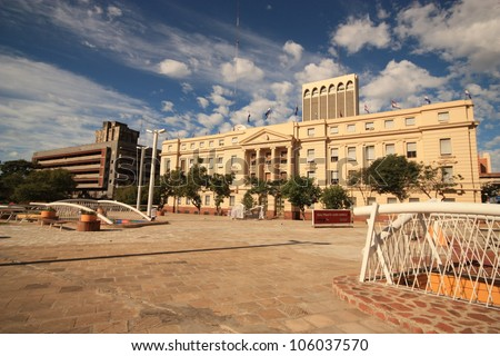 Colorful view on the colonial house and modern house on the square in center of capital Asuncion, Paraguay. South America. - stock photo