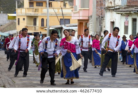 COLORFUL VILLAGE PARADE, GUAMOTE, ECUADOR - July 23, 2016:  Indigenous people are dancing in parade in Guamote, Ecuador