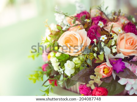 Colorful Vintage  decoration artificial flower near sunlight - stock photo