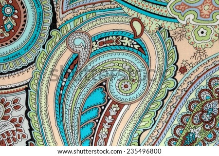 colorful vintage fabric with blue and beige paisley print - stock photo