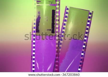 Colorful vintage film strip background - stock photo