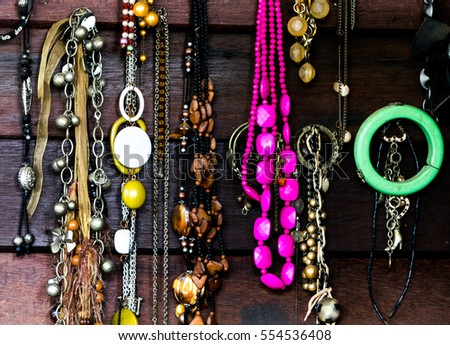 colorful Vintage necklace on wooden wall.