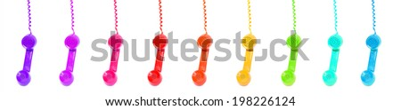 colorful vintage telephone receivers isolated on white background - stock photo