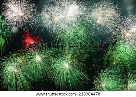 Colorful volleys fireworks in the night sky - stock photo