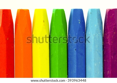 colorful wall by crayon stand on white isolate background