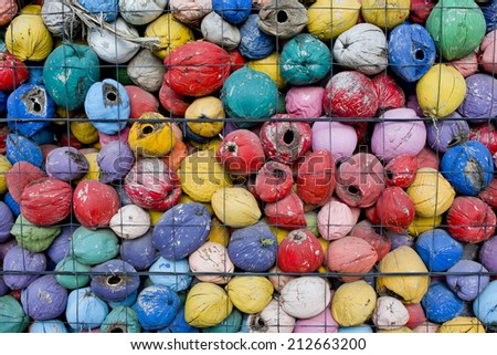 colorful waste of coconut husks in grate background texture. - stock photo