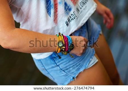 colorful watch wristband on stylish female hand - stock photo