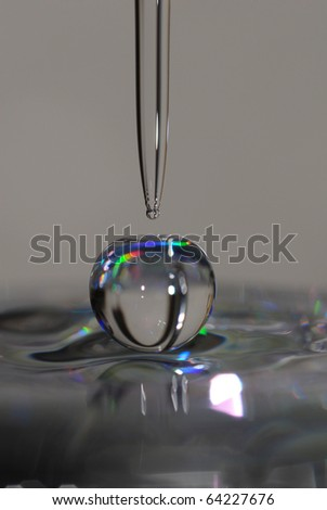 Colorful water droplet macro - stock photo