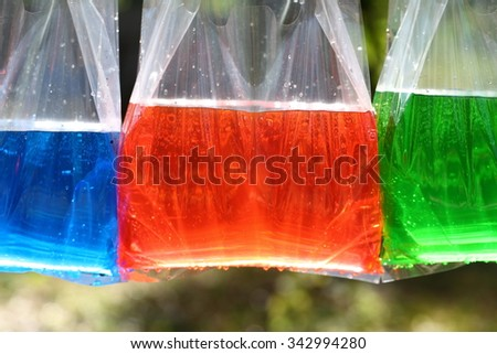 Colorful water in plastic bag - stock photo