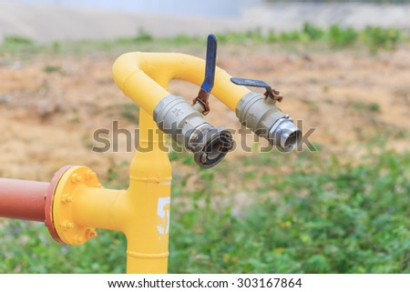 colorful water valve pump in nature background - stock photo