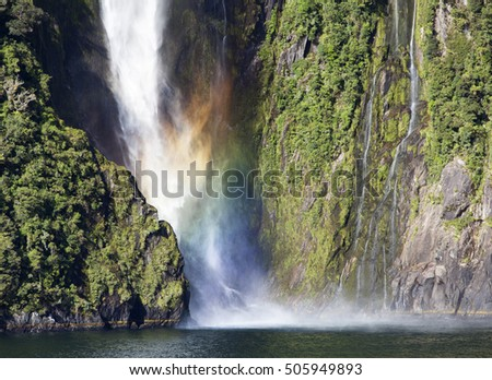 Colorful waterfall of Milford Sound in Fiordland National Park (New Zealand).