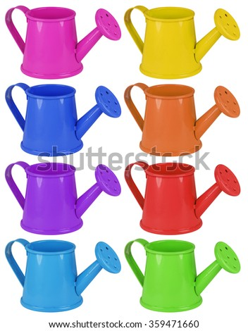 Colorful watering cans isolated on white background. - stock photo
