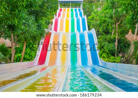 Colorful waterslides in water park, Vietnam, Southeast Asia - stock photo