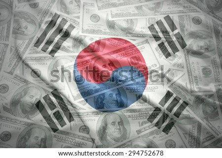 colorful waving south korea flag on a american dollar money background - stock photo