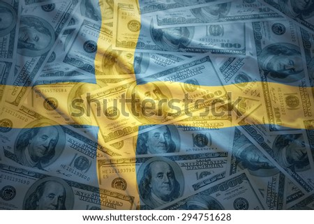 colorful waving swedish flag on a american dollar money background - stock photo