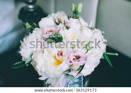 Colorful wedding bouquet in vase in bridal suite