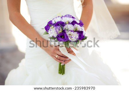 Colorful wedding bouquet with eustomas  in bride's hands - stock photo