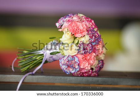 Colorful wedding flowers at wooden table. Wedding bouquet of Bride at Bridal day in spring.