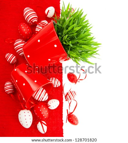 colorful white red painted easter eggs with green grass over table cover. festive decoration - stock photo