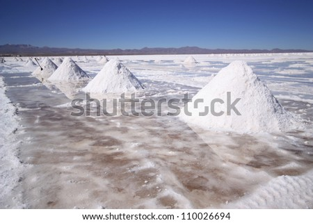 Colorful white salt pyramids in the world's largest salt desert, Salar Uyuni, Bolivia, near border with Chile, south America. - stock photo