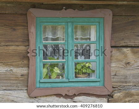 colorful window in wooden cottage
