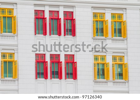 colorful windows on building - stock photo