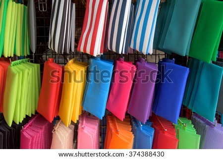 Colorful woman small bags hanging for sale - stock photo