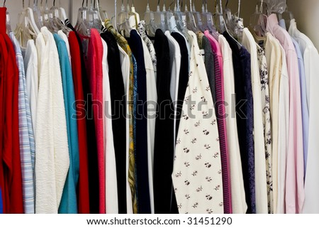 Colorful women's clothing in a closet or a retail store