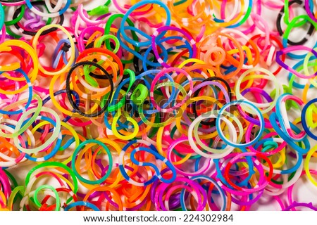 colorful wonder loom band rubber isolated on white - stock photo