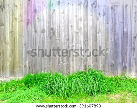 Colorful wood fence have green grasses at bottom look like nest for egg that mean can put object on grass, Wood texture - stock photo