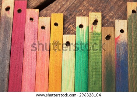 Colorful wood stain color test wood samples, on rough wood. - stock photo