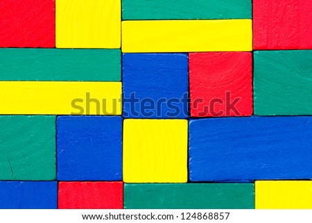 Colorful wood texture made of small toy blocks
