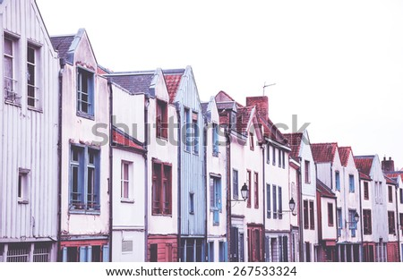 Colorful wooden and stone houses in Saint Leu quarter. Amiens, France. Toned photo with haze. - stock photo