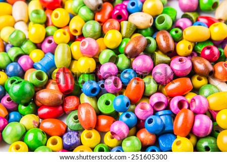 Colorful wooden beads background - stock photo