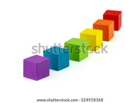 Colorful wooden blocks lined up. - stock photo